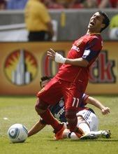 Trent Nelson  |  The Salt Lake Tribune Real Salt Lake's Javier Morales falls with a horrific injury, with Chivas USA's Marcos Mondaini defending. Real Salt Lake vs. Chivas USA, MLS Soccer at Rio Tinto Stadium in Sandy, Utah, Saturday, May 7, 2011.