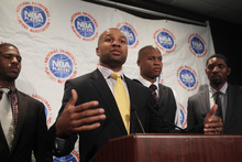 Derek Fisher, center, speaks during a news conference following NBA basketball labor talks on Thursday, Oct. 20, 2011, in New York. From left, Chris Paul, Maurice Evans and Roger Mason Jr. look on.(AP Photo/Frank Franklin II)
