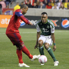 Stephen Holt/ Special to the Tribune Real Salt Lake midfielder Andy Williams slides the ball past Portland Timbers' defender Rodney Wallace in the first half at Rio Tinto Stadium in Sandy.