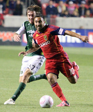 Stephen Holt/ Special to the Tribune Real Salt Lake forward Arturo Saborio works past Portland Timbers midfielder Eric Alexander in the second half of the 1-1 tie at Rio Tinto Stadium in Sandy.
