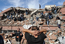 People try to save people trapped  under debris in Tabanli village near the city of Van after a powerful earthquake struck eastern Turkey Sunday Oct. 23, 2011, collapsing some buildings and causing a number of deaths, an official said. ( AP Photo/ Abdurrahman Antakyali, Aatolia) TURKEY OUT