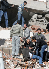 Abdurrahman Antakyali  |  The Associated Press People try to save people trapped under debris Sunday in Tabanli village in Turkey after a powerful earthquake struck.