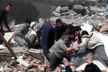 People rescue two women trapped under debris in Van  eastsern Turkey after a powerful 7.2-magnitude earthquake struck eastern Turkey, collapsing about 45 buildings in Van province, Sunday, Oct. 23, 2011 according to the deputy Turkish prime minister. Only one death was immediately confirmed, but scientists estimated that up to 1,000 people could have been killed. The worst damage was caused to the town of Ercis, in the mountainous eastern province of Van, close to the Iranian border. ( AP Photo/Ali Ihsan Ozturk, Anatolia) TURKEY OUT