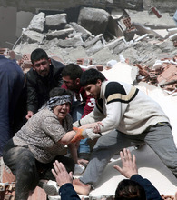 People rescue a woman trapped under debris after a powerful 7.2-magnitude earthquake struck eastern Turkey, collapsing about 45 buildings in Van province, Sunday, Oct. 23, 2011 according to the deputy Turkish prime minister. Only one death was immediately confirmed, but scientists estimated that up to 1,000 people could have been killed. The worst damage was caused to the town of Ercis, in the mountainous eastern province of Van, close to the Iranian border. ( AP Photo/ Ali Ihsan Ozturk, Aatolia) TURKEY OUT