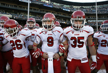 Scott Sommerdorf  |  The Salt Lake Tribune              Utah quarterback Jon Hays (9) and the rest of the team link arms prior to taking the field. The Cal Bears held a 20-0 halftime lead over Utah at AT&T Park in San Francisco, Saturday, October 22, 2011.