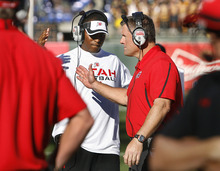 Scott Sommerdorf  |  The Salt Lake Tribune              QB coach Brian Johnson slaps hands with head coach Kyle Whittingham just prior to kickoff against Cal. The Cal Bears held a 20-0 halftime lead over Utah at AT&T Park in San Francisco, Saturday, October 22, 2011.