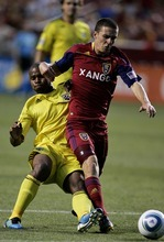 Djamila Grossman  |  The Salt Lake Tribune  Real Salt Lake plays Columbus Crew at Rio Tinto Stadium in Sandy, Utah, on Saturday. The Crew's Julius James (26) tries to reach the ball past RSL's Will Johnson (8).