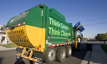 Al Hartmann  |  The Salt Lake Tribune  A Waste Management garbage truck that runs on compressed natural gas collects recycled materials in West Valley City. The truck cuts down on emissions and makes less noise.
