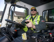 Al Hartmann  |  The Salt Lake Tribune  Dustin Marcek, a driver for Waste Management, is collecting garbage in a truck that runs on compressed natural gas, which reduces emissions.