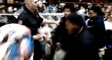 A screen grab from video showing Roosevelt police dispersing a crowd using pepper spray.