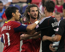 Rick Egan  |  The Salt Lake Tribune  Kyle Beckerman gets a shove from Branko Boskovic from D.C. United as Real Salt Lakes Javier Morales steps during their match at Rio Tinto Stadium on Saturday.
