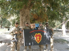 an appreciative infantry platoon in Afghanistan, holding packs of the