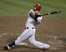 Texas Rangers' Mike Napoli hits a three-run home run during the sixth inning of Game 4 of baseball's World Series against the St. Louis Cardinals Sunday, Oct. 23, 2011, in Arlington, Texas. (AP Photo/Tony Gutierrez)
