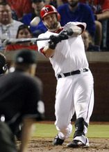 Texas Rangers' Mike Napoli hits a three-run home run off St. Louis Cardinals' Mitchell Boggs during the sixth inning of Game 4 of baseball's World Series Sunday, Oct. 23, 2011, in Arlington, Texas. (AP Photo/Eric Gay)