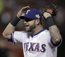 Texas Rangers' Mike Napoli reacts after St. Louis Cardinals' Matt Holliday was called safe at first during the fourth inning of Game 3 of baseball's World Series Saturday, Oct. 22, 2011, in Arlington, Texas. (AP Photo/Charlie Riedel)