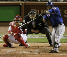 Texas Rangers' Mike Napoli hits a two-run home run off St. Louis Cardinals' Chris Carpenter during the fifth inning of Game 1 of baseball's World Series Wednesday, Oct. 19, 2011, in St. Louis. (AP Photo/Jeff Roberson)