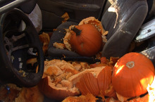 Pumpkins dropped from the Trolley Square Water Tower during the K-Bull 93 pumpkin drop litter the seat of a Saturn car. The pumpkins were dropped through the sunroof of the car, 80 feet below on Thursday, October 27, 2011.  Rick Egan  | The Salt Lake Tribune