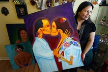 Francisco Kjolseth  |  The Salt Lake Tribune Local artist Veronica Perez holds her painting