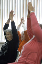 Francisco Kjolseth  |  The Salt Lake Tribune Stretching their arms doing seated yoga poses, Donna Thomas, 84, Mary Alice Larsen, 68, and Karen Teter, 70, from left, exercise in Margaret Crowell's class in an effort to battle the arthritis pain they all suffer on various parts of their body. Crowell teaches a weekly P.A.C.E. (People with Arthritis can Exercise) class at the Mt. Olympus Senior Center.