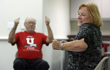 Francisco Kjolseth  |  The Salt Lake Tribune Margaret Crowell, right, teaches her weekly P.A.C.E. (People with Arthritis can Exercise) class at the Mt. Olympus Senior Center at 1635 E. Murray-Holladay Road on a recent Thursday afternoon as Ellwood Crowell, 79, in background, works his arms.