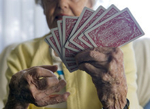 Al Hartmann  |  The Salt Lake Tribune A 75-year old woman with osteo and rheumatoid arthritis.  She has lived with the condition for  35 years.  It limits her life in some ways but she still is able to play cards.