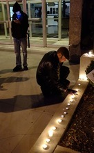 Trent Nelson  |  The Salt Lake Tribune Justin Kramer lights candles in front of the Public Safety Building in Salt Lake City on Wednesday, Oct. 26, 2011. About two dozen protesters with Occupy Salt Lake marched from Pioneer Park to the Public Safety Building. They lit candles to show appreciation for the Salt Lake City police, but to protest the actions of the police in Oakland, Calif.