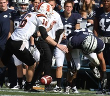 Rick Egan    The Salt Lake Tribune   Idaho State Bengals punter David Harrington (16) tries to grab a blocked punt along with Brigham Young Cougars linebacker Jameson Frazier (48), in football action,  BYU vs. Idaho State University football game, at Lavell Edwards Stadium, Saturday, October 22, 2011.