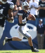 Rick Egan    The Salt Lake Tribune   Brigham Young Cougars quarterback Riley Nelson (13)looks downfield,  in football action,  BYU vs. Idaho State University football game, at Lavell Edwards Stadium, Saturday, October 22, 2011.