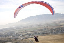 Djamila Grossman  |  The Salt Lake Tribune  United States military veterans paraglide at South Side Flight Park, Point of the Mountain in Draper, Utah, on Saturday, Oct. 29, 2011. The veterans paired up with pilots of the Utah Hang Gliding and Paragliding Association for tandem flights.