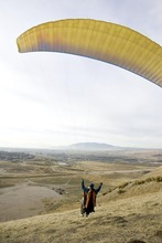 Djamila Grossman  |  The Salt Lake Tribune  United States military veterans paraglide at South Side Flight Park, Point of the Mountain in Draper, Utah, on Saturday, Oct. 29, 2011. The veterans paired up with pilots of the Utah Hang Gliding and Paragliding Association.