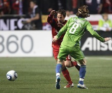 Rick Egan  | The Salt Lake Tribune   Seattle Sounders defender Zach Scott (20),  stops Seattle Sounders defender Zach Scott (20) as he goes for the ball, in MLS soccer action, Real Salt Lake vs. the Seattle Sounders, in Sandy, Saturday, October 29, 2011Saturday, October 29, 2011. Friberg (8), was given a yellow card on the play.