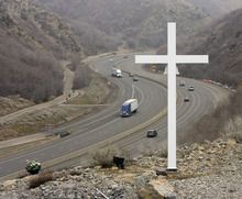 A cross along Interstate 80 about up Parleys Canyon memorializes Trooper Dan Harris, who died there in 1982 while chasing a speeder.   The cross is set above the roadway about 2 miles up the canyon.   Al Hartmann/The Salt Lake Tribune     3/9/09