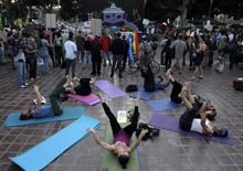 A group of Occupy Los Angeles protesters participate in a yoga class before a rally in Los Angeles, Wednesday, Nov. 2, 2011. At its peak, about 300 protesters marched peacefully through the city to express solidarity with Occupy Wall Street activists in Oakland who had called for a