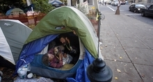 Occupy Portland protesters Lisa Mackie and William Fowler open their tent at the Occupy Portland camp in Portland, Ore., Wednesday, Nov. 2, 2011. Temperatures in Portland have been dipping into the 30's the last few nights, leaving people at the camp struggling to keep warm. About 500 protestors have been living in Chapman and Lownsdale squares downtown since the day of Occupy Portland's initial march through the city on Oct. 6. (AP Photo/Rick Bowmer)