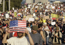 Thousands of Occupy Wall Street demonstrators march from downtown Oakland, Calif., to the port of Oakland Wednesday, Nov. 2, 2011. Protestors escalated their tactics beyond marches, rallies and tent camps Wednesday and moved to disrupt the flow of goods at the nation's fifth-busiest port. (AP Photo/Paul Sakuma)