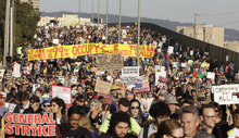 Thousands of Occupy Wall Street demonstrators march from downtown Oakland, Calif., to the port of Oakland, Wednesday, Nov. 2, 2011. Protestors escalated their tactics beyond marches, rallies and tent camps Wednesday and moved to disrupt the flow of goods at the nation's fifth-busiest port. (AP Photo/Paul Sakuma)
