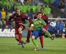 Sounders FC's Mike Fucito, center, tries to keep the ball away from Real Salt Lake's Chris Wingert, left, and Chris Schuler (background) during the first half during an MLS Cup Playoff match at CenturyLink Field on Wednesday, Nov. 2, 2011, in Seattle, Wash.  (John Lok / The Seattle Times)