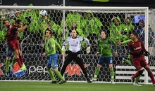 Sounders FC goalkeeper Kasey Keller tries to fend off an attack by the Real Salt Lake offense in the second half during an MLS Cup Playoff match at CenturyLink Field on Wednesday, Nov. 2, 2011, in Seattle, Wash. Real Salt Lake won and will advance to the next round.   (John Lok / The Seattle Times)