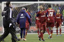 Real Salt Lake's Kyle Beckerman, center, celebrates with his teammates after his team advanced to the MLS Western Conference championship by holding the Seattle Sounders to a 2-0 Sounders win, Wednesday, Nov. 2, 2011, in Seattle. Real Salt Lake beat the Sounders 3-0 Saturday. (AP Photo/Ted S. Warren)