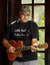 In this Aug. 16, 2011 photo, Vince Gill is shown at his home in Nashville, Tenn. Gill's latest release is titled