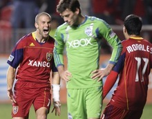 Rick Egan  | The Salt Lake Tribune   Real Salt Lake midfielder Chris Wingert and midfielder Javier Morales (11) celebrate a first-half goal Saturday during their match against the Seattle Sounders in Sandy. RSL won 3-0.