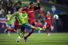 Real Salt Lake's Chris Schuler, right, tries to keep the ball away from Sounders FC's Fredy Montero in the second half during an MLS Cup Playoff match at CenturyLink Field on Wednesday, Nov. 2, 2011, in Seattle. Real Salt Lake won and advances to the next round.  (John Lok / The Seattle Times)