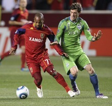 Rick Egan  | The Salt Lake Tribune    Real Salt Lake midfielder Andy Williams (77) goes for the ball along with Seattle Sounders midfielder Brad Evans (3), in MLS soccer action, Real Salt Lake vs the Seattle Sounders, in Sandy, Saturday, October 29, 2011Saturday, October 29, 2011.