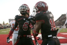 Chris Detrick  |  The Salt Lake Tribune Utah Utes wide receiver Dres Anderson celebrates with Utah Utes wide receiver Reggie Dunn (14) after scoring a touchdown during the first half of the game at Rice-Eccles Stadium Saturday October 29.