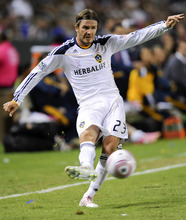 Los Angeles Galaxy midfielder David Beckham, of England, passes the ball during second half of an MLS soccer match against the Real Salt Lake, Saturday, Oct. 1, 2011, in Carson, Calif. The Galaxy won 2-1. (AP Photo/Gus Ruelas)