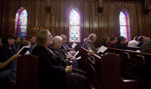 Lennie Mahler  |  The Salt Lake Tribune Members of an interfaith congregation sing a hymn during a service about being LDS and LGBTQ. The service was part of a three-day conference called