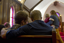 Lennie Mahler  |  The Salt Lake Tribune Steven Bristow and Michael Budge, who have been together about five months, listen during an interfaith service about being LDS and LGBTQ. The service was part of a three-day conference called