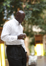 Charlotte Bobcats owner Michael Jordan walks back to join a meeting of the NBA basketball team owners in Dallas, Thursday, Sept. 15, 2011. (AP Photo/LM Otero)