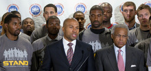 FILE - In this Sept. 15, 2011 file photo, Los Angeles Lakers' Derek Fisher, center, president of the NBA players union, is joined by union executive director Billy Hunter, right, and  NBA players during a news conference in Las Vegas. The players are fighting. The owners are fighting. And that's just among themselves. Just wait until they return to the bargaining table on Saturday, Nov. 5, 2011 with threats of union decertification and eroding offers from the owners poisoning what already was a toxic atmosphere.   (AP Photo/Julie Jacobson, File)