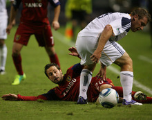 Kim Raff |  The Salt Lake Tribune Real Salt Lake player (left) Ned Grabavoy taps the ball around the feet of LA Galaxy player Chris Birchall during the second half of the Western Conference Championship at The Home Depot Center in Carson, CA on Sunday, November 6, 2011.